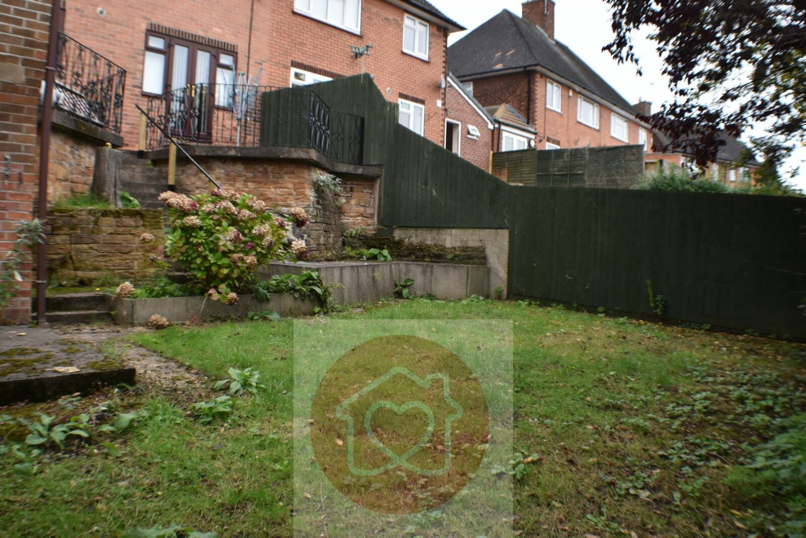 IDEAL FAMILY HOME 3 bedrooms. 2 very large doubles. 2 reception rooms. Large utility/office/workshop with loft. Extended to incorporate: Heated Garage / workshop space. Storage / garden room with French doors at garden level.FGCH. Raised patio. Grassed garden area. Easy to maintain.